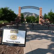 A Protect Our Herd–face covering required sign at the entrance of Farrand Field