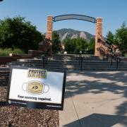 A Protect Your Herd sign seen in front of Farrand Field