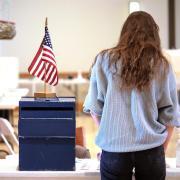Campus community member voting in the UMC