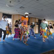 Nii Armah Sowah, center, leads a dance class