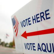 Sign with arrow pointing to voting area