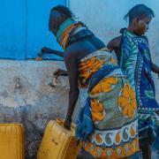 People gathering water in urban Africa