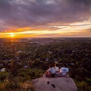 CU Boulder students watch sunset from Flagstaff Mountain
