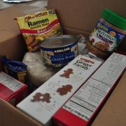 Inside a box of donated non-perishable foods