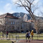 Students walk across Norlin Quad
