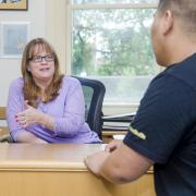 Academic advisor meets with a student in her office