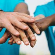 Volunteers put their hands together