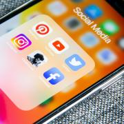 Screenshot of a mobile phone with social media icons