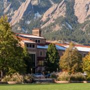 An image of Wardenburg Health with the Flatirons in the background. (Photo by  Patrick Campbell/University of Colorado)