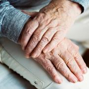 Stock photo of wrinkled hands.