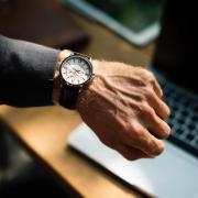 Man checks wrist watch