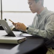 person working on laptop inside