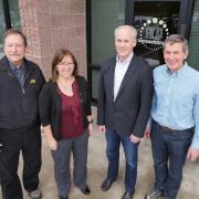 Professor Alan Weimer, CU Boulder alum Karen Buechler, CU Boulder alum Mike Masterson and ProfessorSteve George at ALD NanoSolutions in Broomfield, Colorado.