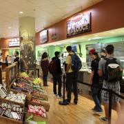 Students line up inside the Alferd Packer Grill