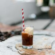 root beer float with ice cream and a red striped paper straw