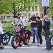 People participate in an alternative fuel vehicle ride-n-drive expo