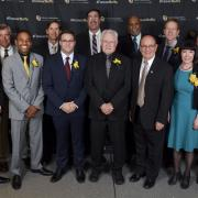 Chancellor poses for photo with alumni award recipients
