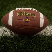 A football on a field.