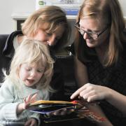 Graduate student Abby Stangl works with blind preschoolers at the Anchor Center for the Blind