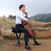 Musician playing cello outside