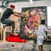 Armando Silva painting on a canvas
