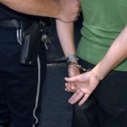 Woman is handcuffed by police officer