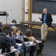 Professor teaches large class