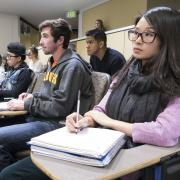 Students listen to lecture in classroom