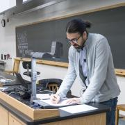 A lecturer teaching in front of a class