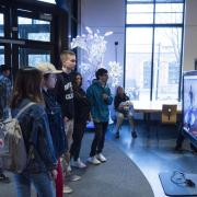 Visitors check out more than 100 student projects on display at the ATLAS expo. Photo by Patrick Campbell.