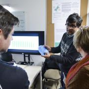 Student shows his work during ATLAS Institute Research Showcase