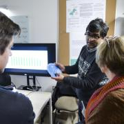 A person shows his work during the ATLAS Institute Research Showcase.