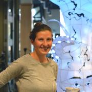 ATLAS doctoral student Lila Finch with Luminous Science project