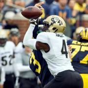 CU's Chidobe Awuzie collects a sack and forced fumble against Michigan earlier this year