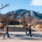 Students walk by Farrand Field, where many of the surrounding oak trees are infested with Allokermes scale