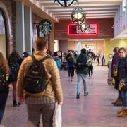 Students walk through the UMC