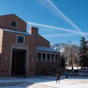 The fountain near the UMC with a dusting of snow, blue skies overhead
