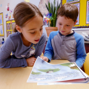 Boy and girl reading a book in the writing class