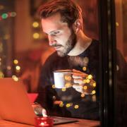 Man looking at screen at night