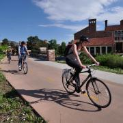 Employees bike to work along the Boulder Creek Path