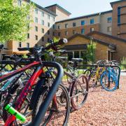 Bikes parked on rack on campus