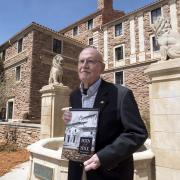 Campus Architect Emeritus Bill Deno poses for photo with new Body & Soul book