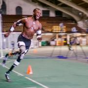 Blake Leeper sprints around the track at CU Boulder