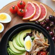 Salad bowl, fruit and a boiled egg