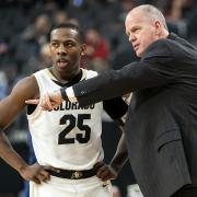 McKinley Wright IV with 10th-year head coach Tad Boyle