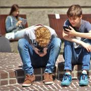 Two boys on their smartphones