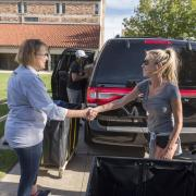 Boulder City Manager Jane Brautigam, left, greets Kim Ward of Lake Forest, IL, during move-in