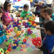 Children creating colorful paper sculptures