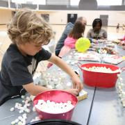 Kids participate in making crafts at Bring Your Child to Work Day at CU Boulder