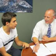 Attorney Bruce Sarbaugh consults a student